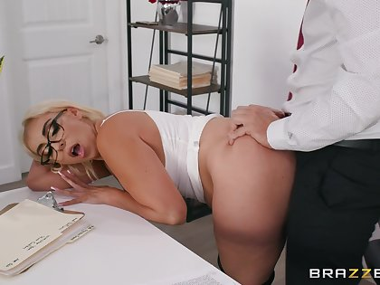 Blonde cougar enjoys a bit of naughty sex at the office