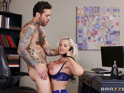 Busty fair-haired office lady Alena Croft fucked on the table by her boss
