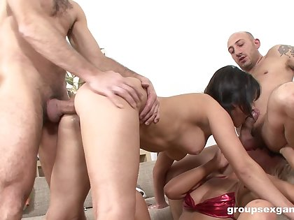 Bitches are being hard fucked in a wild foursome