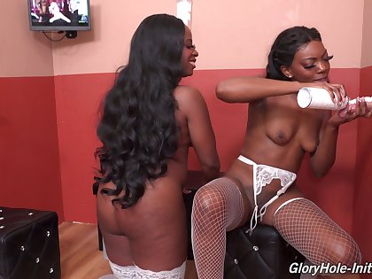 Insolent ebony sluts try the big dicks through the glory hole